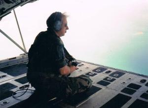J.C. as we knew him, looking out the back of a C-130 high over somewhere.