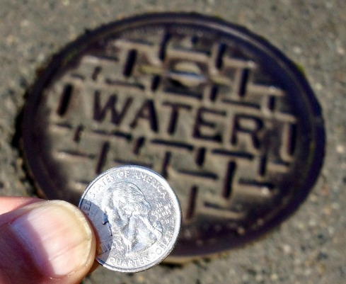 The Coin and the Manhole Cover